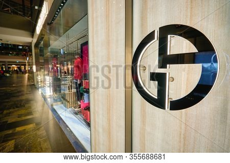 SINGAPORE - JANUARY 20, 2020: close up shot of Giorgio Armani sign seen in the Shoppes at Marina Bay Sands. Giorgio Armani S.p.A. is an Italian luxury fashion house.