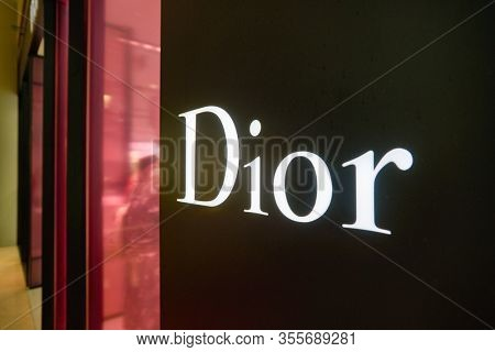 SINGAPORE - JANUARY 20, 2020: close up shot of Dior sign seen in the Shoppes at Marina Bay Sands. Christian Dior SE is a French luxury goods company.
