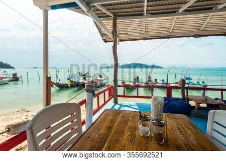 Ko Samui, Thailand - January 2, 2020: Authentic Thai Fishing Boats Viewed Through French Bakery Terr
