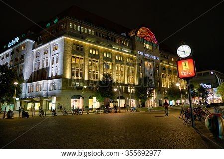 BERLIN, GERMANY - CIRCA SEPTEMBER, 2019: street level view of Kaufhaus des Westens (KaDeWe) in Berlin at night.
