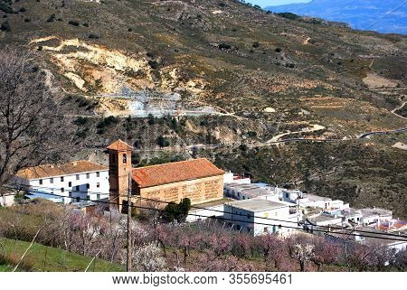 View Of Church And Town Rooftops, Alcutar, Las Alpujarras, Granada Province, Andalucia, Spain.  Subj