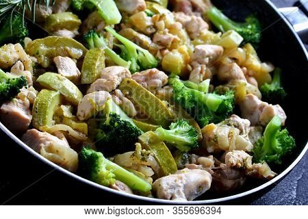 Skinless Boneless Chicken Meat With Low Carb Green Vegetables: Zucchini, Broccoli, Onion, And Rosema