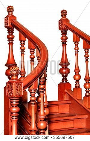 Fragment Beautiful Of A Wooden Staircase With Figured Carved Curved Balusters And Railings And Tinte