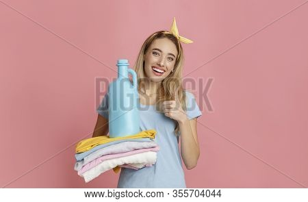 Smilling Housewife Showing Thumb Up Approval Of Fabric Softener, Free Space