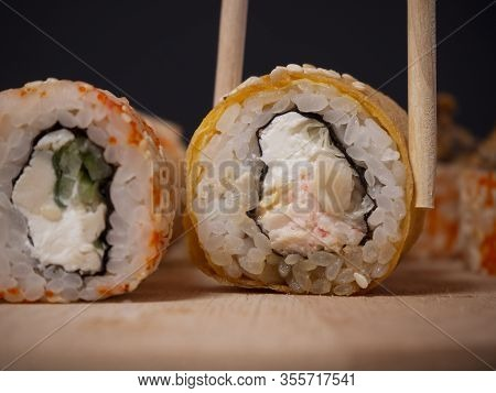Sushi Roll With Tamago Omelette, Crab Cream, Teriyaki Salmon, Cream Cheese, Avocado And Sesame Seeds