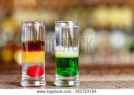 Different Cocktails On The Bar In A Restaurant Or In A Pub, Multilayered Alcoholic Drinks