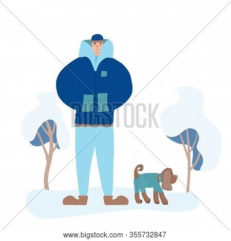 Young Man Dressed In Trendy Comfy Clothes Walking With His Dog. Male Teenager Wearing In Winter Cozy