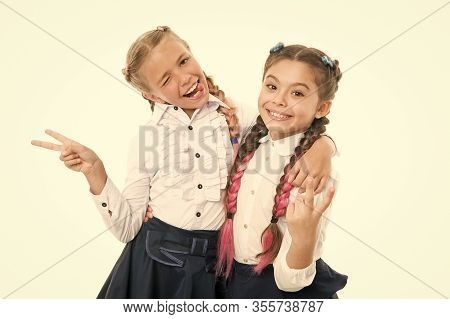V Is For Victory. Little Schoolgirls Making Victory Gestures Isolated On White. Cute Small Winners E