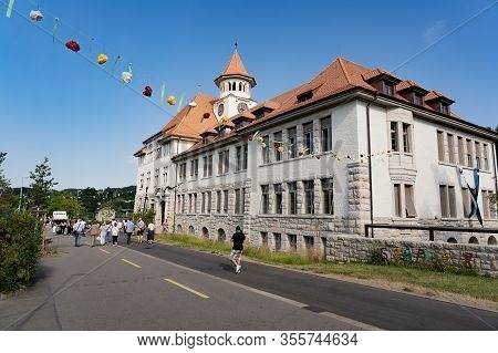 Garland Of Paper Flower In Front Of A Swiss Primary School Stapferschulhaus Brugg On Sunny Morning W