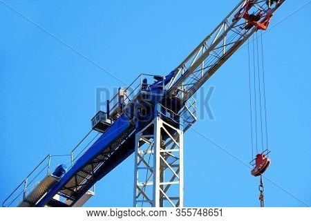 Crane. Close Up. Self-erecting Crane Against Blue Sky.
