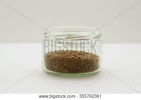 Glass Jar With Lentils On A White Background, Side View. The Concept Of Healthy Nutrition, Diets, Ve