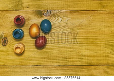 Painted Easter Eggs And Colors For Painting On Wooden Table