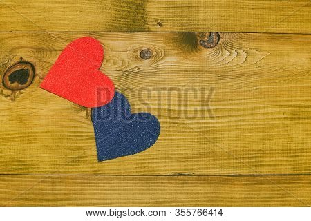 Image Of Blue And Pink Heart Shape On Wooden Table