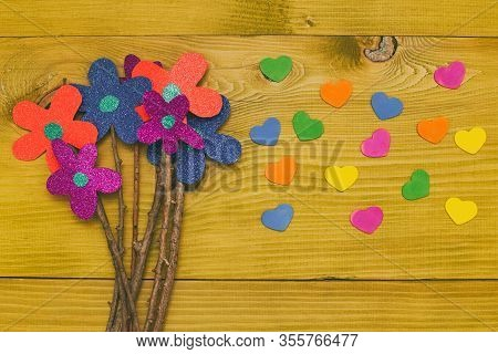 Bouquet Of Flowers With Heart Shapes On Wooden Table.