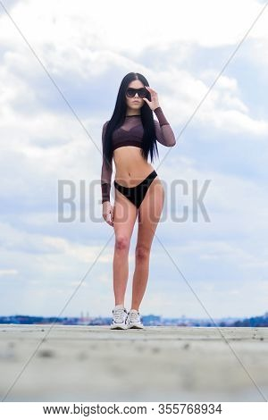Abs. Freedom. Sensual Girl In Underwear Lingerie And Sunglasses Outdoor. Sexy Woman With Fit Body. S