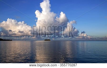 Beautiful Cumulus Clouds Over Pacific Ocean In The Leeward Group Of The Society Islands Of French Po