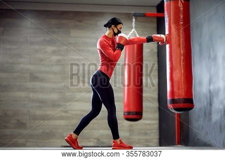 Coronavirus Covid-19 Prevention, Fight. Girl With A Medical Mask And Boxing Gloves. Fighting Viruses
