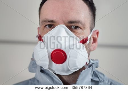 Face Of A Man With A Protective Mask On His Face. A Man Wearing A Protective Suit.