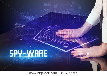 Hand touching digital table with SPY-WARE inscription, new age security concept