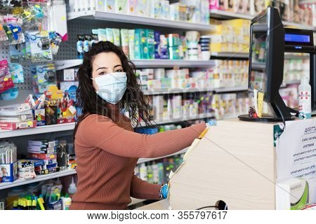 Avetrana, Italy, - Marth, 13, 2020. Beautiful Young Cashier With Medical Mask And Gloves Working At
