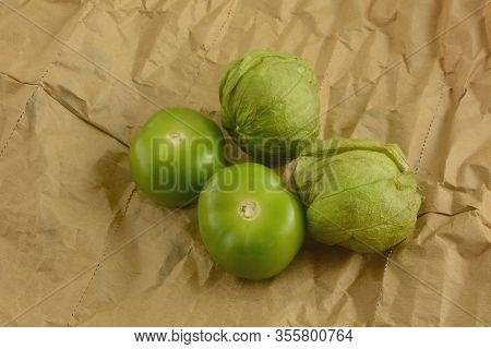 Fresh Raw Tomatillos With And Without Skins On Eco-friendly Brown Paper