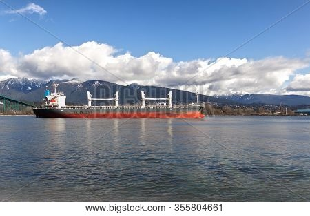 Vancouver, Canada - March 4,2020: A Cargo Ship Is Heading To Vancouver Harbour With North Vancouver