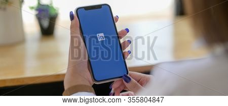 Chiang Mai, Thailand - March 13, 2020 : Female Holding Iphone With Linkedin Screen. Linkedin Is Mobi