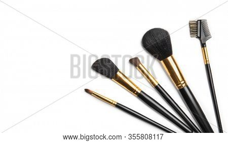 Make-up Brushes set over white background. Various Professional makeup brush on white in studio. Make up artist tools. Flatlay, top view, flat lay border backdrop