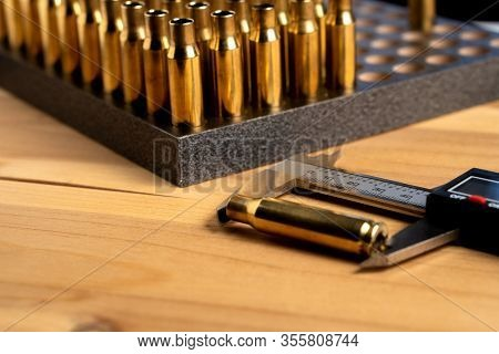 Production Of Cartridges For A Rifle, Reload. Measurement Of The Empty Cartridges With A Caliper
