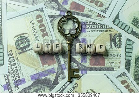 The Ltf And Rmf   Wooden Cube  Gold Key Vintage On Banknotes For Business Content.