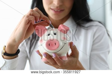 Nice Girl Puts A Coin In Ceramic Pig Figurine. Know Assortment Stores And, Reaching Out Only Hand, I
