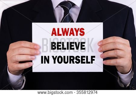 Businessman Holding A Card With Text Always Believe In Yourself
