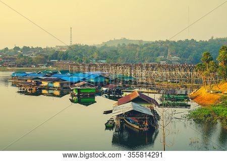 Houseboats And Mon Bridge (uttamanusorn Bridge) At Sam Pra Sob In Sangkhla Buri District, Kanchanabu