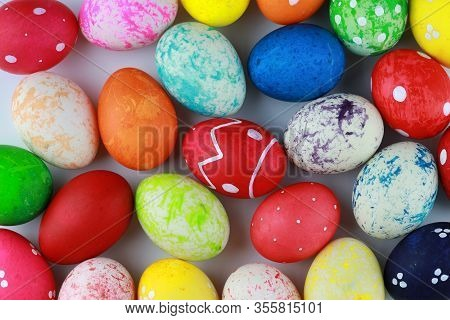 Closeup Group Colorful And Decorated Easter Eggs On White Table Background Isolated. Advertising Ima