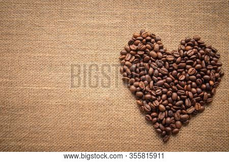 Heart Shaped Coffee Beans On Sackcloth Or Sackcloth As A Background Image Of Linen Canvas Blankets O