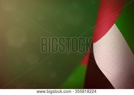 United Arab Emirates Hanging Flag For Honour Of Veterans Day Or Memorial Day On Green Dark Velvet Ba