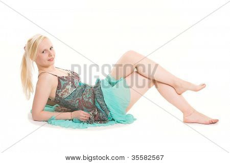 lovely blond in colorful dress. Laying over white background.