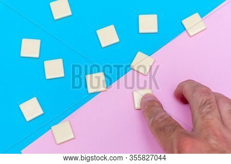 Blue And Pink Background With Scattered Blank Word Tile Blocks With Hand For Concept Of Growth, Goal