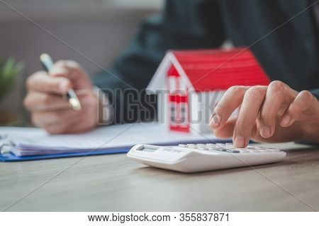 Women Using Calculator To Count Rent, Calculating Mortgage, Loan Or Investment.buying And Selling Ho