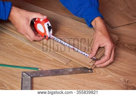 Measure Board Laminate Tape Measure, Mens Hands Measure The Length Of The Floorboard, Laminate The F