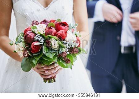 Bride Holds A Wedding Bouquet, Wedding Dress, Wedding Details. Beautiful Luxury Wedding Blog Concept