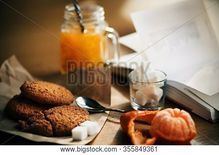 On The Wooden Table The Morning Breakfast - Warm Sea Buckthorn Morse In A Glass Mug, Oatmeal Cookies