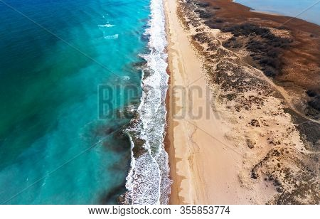 Aerial View Of Beach Shore In The Morning.