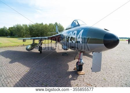 Enschede, Netherlands - August 16, 2018: Old Military Fighter Jet On The Former Military Airfield Ai