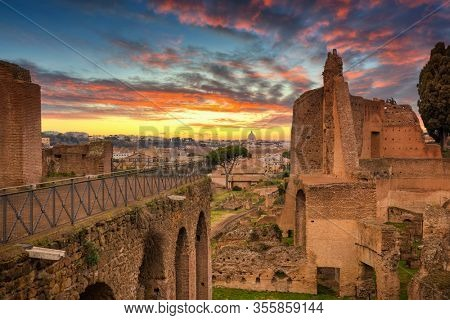 Ruins of the House of Augustus on the Palatine in ancient Rome at sunset, Italy