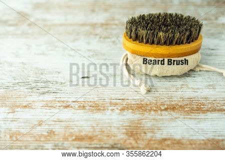 Bamboo Beard Brush With Natural Bristles Insulated On A Wooden Base. Facial Care Concept.