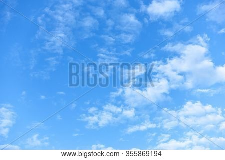 Blue sky with small white fleecy clouds. Natural background
