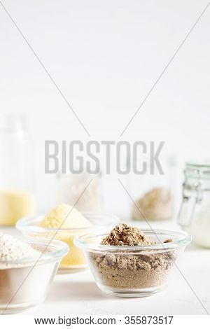 Various Gluten Free Flour Corn,sesame,oat,coconut In Glass Bowl On White Background.alternative To W
