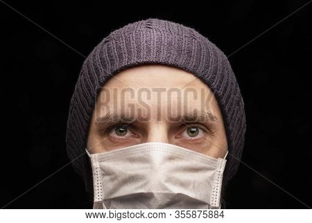 The Man In The Cap At The Medical Protective Mask, Anti-infectious, Protection Against Coronavirus.