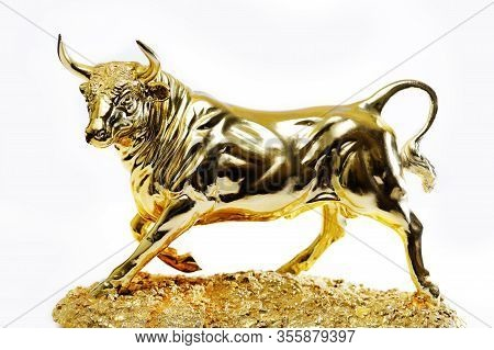 Golden Bull Statue Isolated On White Background. Golden Taurus, A Symbol Of Wealth And Affluence